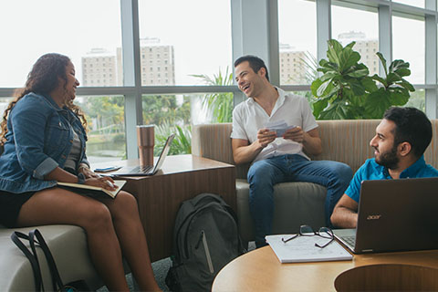 Group of prism students in the shalala student center studying